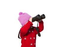 Little girl  looks through binoculars. Stock Photos