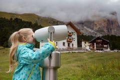 Little girl looks through binoculars Royalty Free Stock Photo
