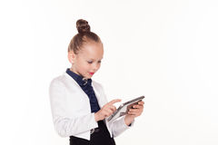 Little girl looks at business Lady tablet computer royalty free stock photos