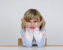 Little girl looks contrary. Little blond girl looks contrary royalty free stock photo