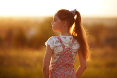 Little girl looks into the distance Stock Photos