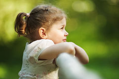Little girl looks into the distance Royalty Free Stock Image