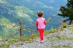 little girl looks at the mountains royalty free stock image