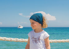 Little girl looks out to sea. Royalty Free Stock Photography
