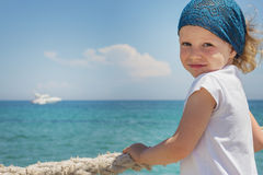 Little girl looks out to sea. Royalty Free Stock Photo