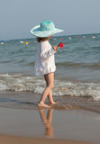 Little girl looks at the sea. Royalty Free Stock Photos