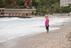 Little girl looks at the sea Royalty Free Stock Photos