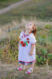 Little girl looks at the sky Stock Images
