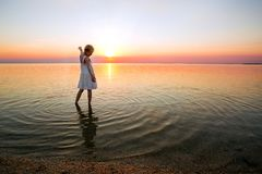 Little girl looks at the sunset royalty free stock images