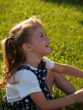 Little Girl looks up to Mommy. A little girl looking up happily Stock Images