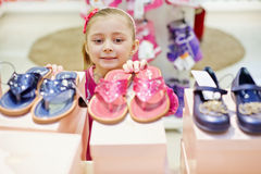 Little girl looks up on toeless shoes Stock Image