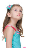 Little girl looks up on the white background Stock Photography