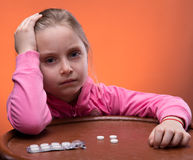 Little girl looks very upset Stock Images