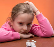 Little girl looks very upset Stock Image
