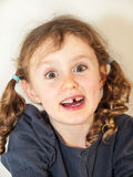 Little girl lost a milk tooth Stock Photography