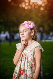 Little girl lost in thought. In park royalty free stock photography