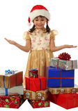 Little girl with lot Christmas gift boxes Royalty Free Stock Image