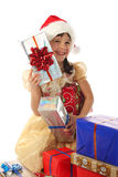 Little girl with lot Christmas gift boxes Royalty Free Stock Photos