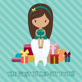 First pulled-out tooth. Little girl with a lot of gifts for the first pulled-out tooth Royalty Free Stock Photography