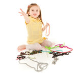 Little girl with a lot of jewel laughing Stock Photography