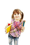 Little girl with lots of colored pencils and books Royalty Free Stock Photos