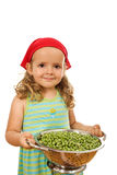 Little girl with lots of peas Royalty Free Stock Photos