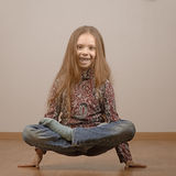 Little girl in lotus position is on hands Stock Photography