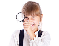 Little girl with loupe Stock Image