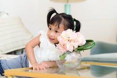 Little girl love flower Stock Image