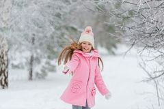 Little girl throws snow up in the air Stock Image