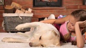 Little girl loves her labrador dog stock footage