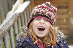 Little girl loving the snow royalty free stock images