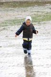 Little girl on low tide tideland Stock Images