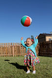 Little girl lti-colored ball stock images