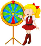 Little girl by the lucky wheel Royalty Free Stock Photo