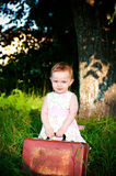 Little girl with lugagge Stock Photography