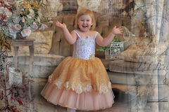 Little girl in the lush yellow with white dress. In the elegant interior Royalty Free Stock Photography