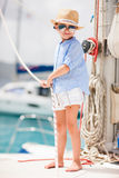Little girl at luxury yacht Stock Images