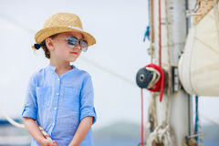 Little girl at luxury yacht Royalty Free Stock Photo
