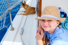 Little girl at luxury yacht with pet dog Royalty Free Stock Photography