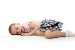 Little girl is lying. Royalty Free Stock Image