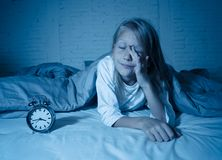 Little girl lying awake in the middle of the night tired and restless suffering sleeping disorders royalty free stock photo