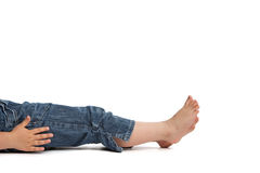 Little girl lying on back Royalty Free Stock Image