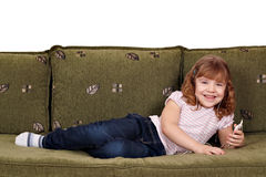 Little girl lying on bed Stock Photos