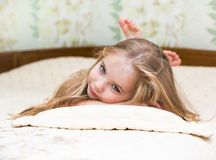 Little girl lying on the bed.  Royalty Free Stock Photo