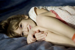 Little girl lying  in bed. Royalty Free Stock Photography