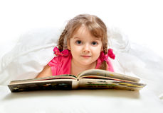 Little girl lying in bed Stock Images