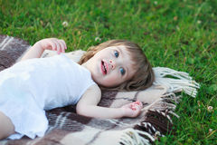 Little girl lying on the blanket Stock Photo