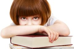 Little girl lying on books Stock Images