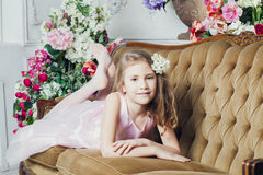 Little girl lying on the couch Stock Image